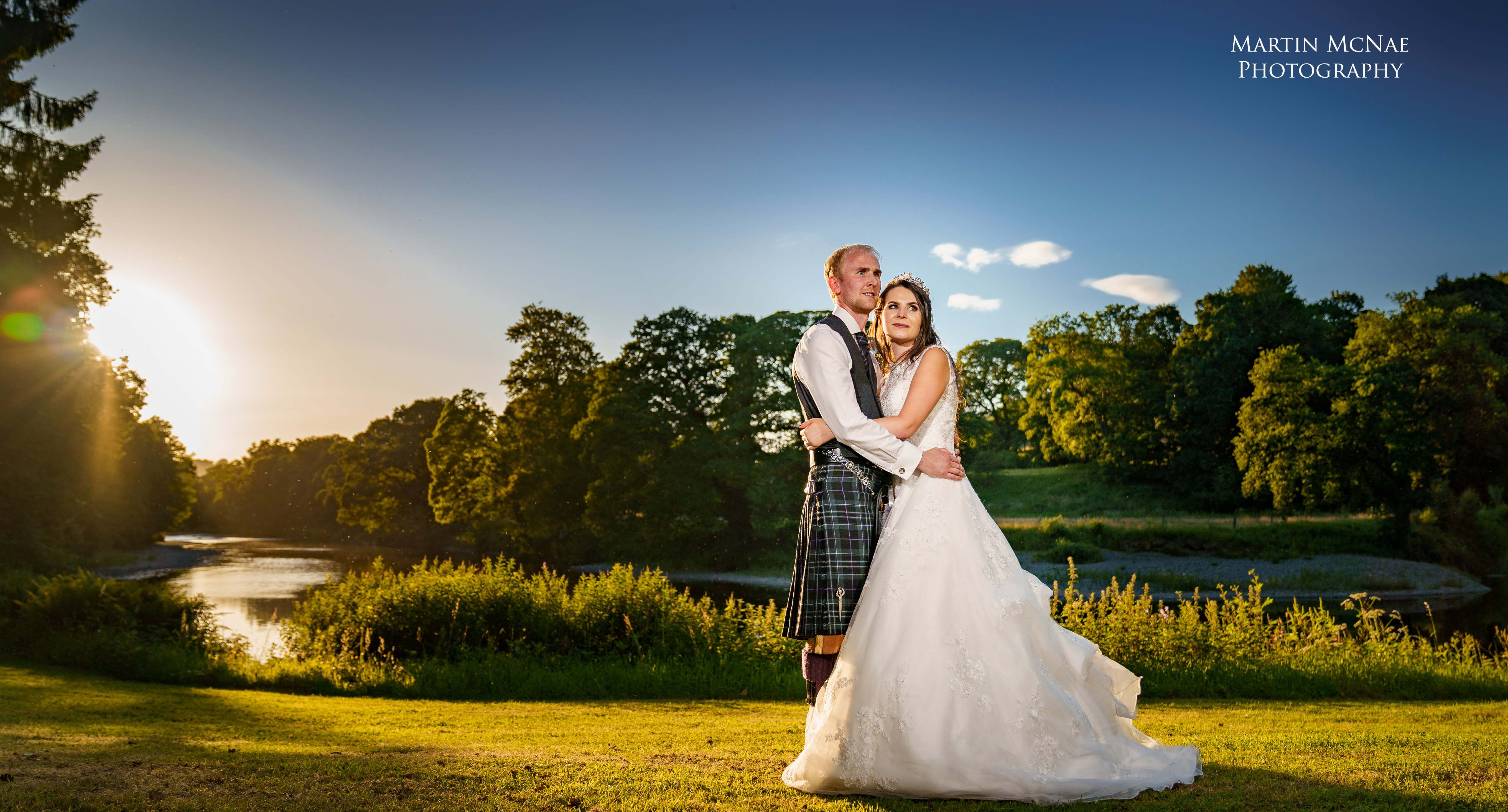 Wedding couple with sunset over River Nith